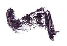 Cepille el strok de la sombra negra del rimel en blanco Imagenes de archivo
