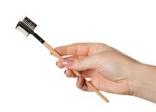 Cepillo cosmético a disposición fotografía de archivo libre de regalías