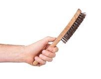 Cepillo de acero aislado en la mano masculina Imagen de archivo libre de regalías