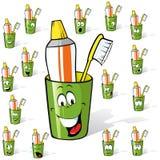 Cepillo de dientes y crema dental Imagenes de archivo