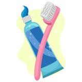 Cepillo de dientes y crema dental Foto de archivo libre de regalías