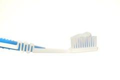 Cepillo de dientes y goma Fotos de archivo libres de regalías