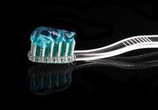 Cepillo de dientes y goma Imagen de archivo libre de regalías