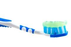 Cepillo de dientes y goma Imagenes de archivo