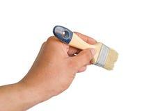 Cepillo de la tenencia de la mano Fotografía de archivo libre de regalías