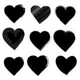 Cepillo de las siluetas del corazón del amor pintado en negro Fotografía de archivo