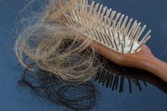 Cepillo de pelo con el pelo Imágenes de archivo libres de regalías