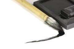 Cepillo de Sumi-e y piedra de la tinta Imagenes de archivo