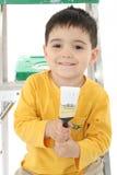 Cepillo del niño y de pintura imagen de archivo libre de regalías