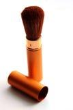 Cepillo del oro para el maquillaje Fotografía de archivo libre de regalías