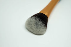 Cepillo del polvo con la manija de oro Imagen de archivo libre de regalías