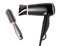 Cepillo del secador de pelo y de pelo aislado Imagenes de archivo