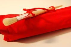 Cepillo en el abrigo rojo Foto de archivo libre de regalías