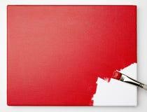 Cepillo que aplica la pintura a la lona Imagenes de archivo