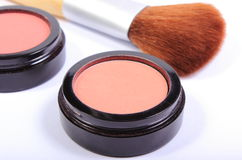 Cepillo y cosméticos para el maquillaje Fotografía de archivo libre de regalías