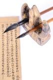 Cepillo y libro de escritura Imágenes de archivo libres de regalías