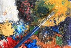 Cepillo y lona de pintura Imagen de archivo