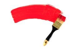 Cepillo y pintura roja Imagen de archivo libre de regalías