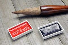Cepillo y tinta asiáticos de escritura para la caligrafía imagen de archivo