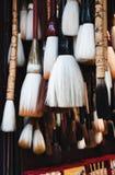 Cepillos chinos de la caligrafía de los recuerdos Pluma en ventas, diverso estilo, diverso tamaño del cepillo del chino imagen de archivo