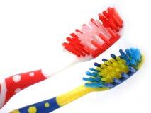 Cepillos de dientes aislados en el fondo blanco Fotografía de archivo libre de regalías