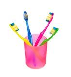 Cepillos de dientes en vidrio Fotografía de archivo