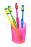 Cepillos de dientes en vidrio Foto de archivo libre de regalías