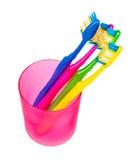 Cepillos de dientes en vidrio Imagen de archivo libre de regalías