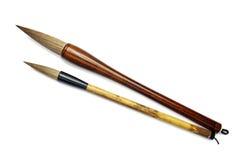 Cepillos de escritura japoneses aislados en blanco Imagenes de archivo