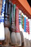 Cepillos de escritura para las decoraciones lunares chinas del Año Nuevo de la caligrafía fotografía de archivo libre de regalías