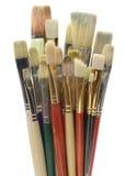 Cepillos de los artistas en blanco Imagenes de archivo