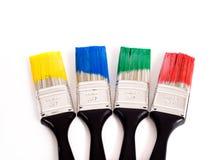 Cepillos de pintura coloridos Imagenes de archivo