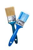 Cepillos de pintura en un fondo blanco Fotos de archivo libres de regalías