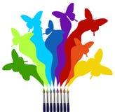 Cepillos de pintura y arco iris coloreado de las mariposas Imagen de archivo libre de regalías