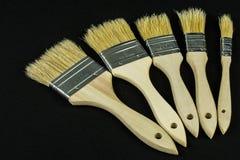 Cepillos dispuestos en un arco Imagen de archivo libre de regalías