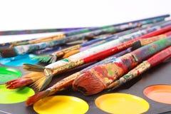 Cepillos y pinturas Imágenes de archivo libres de regalías