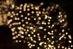 Cequis chispeantes de los efectos luminosos de la Navidad Fotografía de archivo libre de regalías