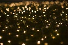 Cequis chispeantes de los efectos luminosos del día de fiesta de la Navidad Foto de archivo
