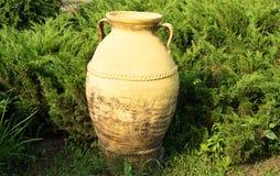 Ceramic amphora in the grass. Yellow ceramic amphora in the grass stock photos