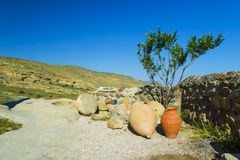 Ceramic ancient amphora for wine on a background of mountains outdoors Royalty Free Stock Photos