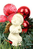 Ceramic Angel and red balls Royalty Free Stock Photography