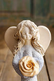 Ceramic angel on wooden table Stock Photos