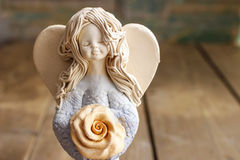 Ceramic angel on wooden table Royalty Free Stock Image