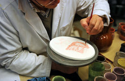 Ceramic artist working, pottery workshop Stock Image