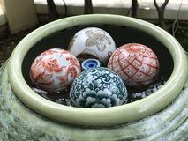 Ceramic balls in water jar. Colorful ceramic balls in water jar Stock Images