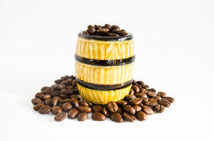 A ceramic barrel full of coffee beans. Isolated on white background Stock Photo