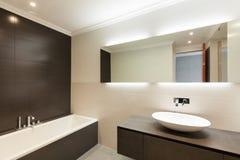 Ceramic basin and mirror. Beautiful modern bathroom, ceramic basin and mirror Stock Image