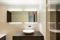 Ceramic basin and mirror. Beautiful modern bathroom, ceramic basin and mirror Royalty Free Stock Photo
