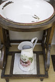 Ceramic basin. Old ceramic sink and wood inside room, building Stock Photo