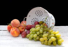 Ceramic basket with summer fruits Stock Images
